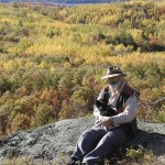 Howard Clifford with Pepi the chihuahua on Blueberry Mountain